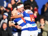 Richard Dunne of Queen Park Rangers celebrates with team mates after scoring during the Sky Bet Championship match between Queens Park Rangers and Burnley at Loftus Road on February 1, 2014