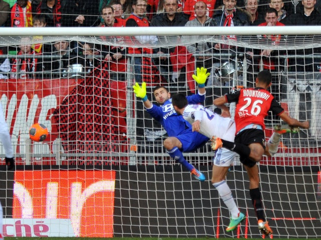 Rennes' French defender Cedric Hountondji scores a header to open the scoring during the French L1 football match Rennes vs Lyon on February 2, 2014