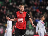 Rennes' Swedish forward Ola Toivonen celebrates after scoring his team's second goal during the French L1 football match Rennes vs Lyon on February 2, 2014