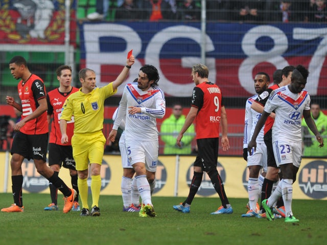Lyon's defender Samuel Umtiti gets a red card from referee Philippe Kalt during the French L1 football match Rennes vs Lyon on February 2, 2014