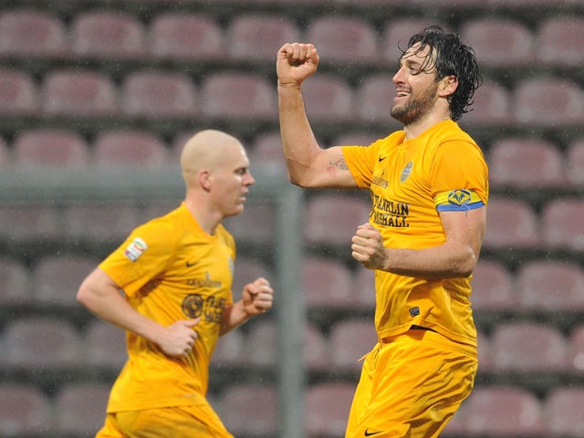 Luca Toni of Hellas Verona celebrates after scoring their second goal during the Serie A match between US Sassuolo Calcio and Hellas Verona FC on February 2, 2014