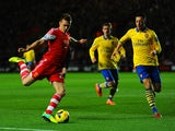 Mesut Ozil of Arsenal has a close eye on Calum Chambers of Southampton during the Barclays Premier League match between Southampton and Arsenal at St Mary's Stadium on January 28, 2014
