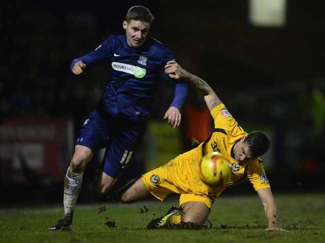 Barry Corr of Southend United battles with Andy Sandell of Newport during the Sky Bet League Two match between Southend United and Newport County at Roots Hall on January 31, 2014