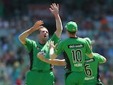 John Hastings of the Stars congratulates Luke Wright after he took a catch off his bowling to dismiss Mitchell Marsh of the Scorchers during the Big Bash League match between the Melbourne Stars and the Perth Scorchers at Melbourne Cricket Ground on Janua