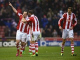 Charlie Adam of Stoke City celebrates scoring his second goal during the Barclays Premier League match between Stoke City and Manchester United at Britannia Stadium on February 1, 2014