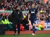 Jonny Evans of Manchester United leaves the field with an injury during the Barclays Premier League match between Stoke City and Manchester United at Britannia Stadium on February 1, 2014