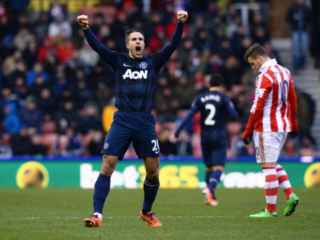 Manchester United's Dutch striker Robin van Persie celebrates scoring an equalising goal during the English Premier League football match between Stoke City and Manchester United at the Britannia Stadium in Stoke on Trent on February 1, 2014