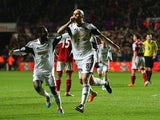 Jonjo Shelvey of Swansea City celebrates scoring the opening goal alongside Nathan Dyer during the Barclays Premier League match between Swansea City and Fulham at the Liberty Stadium on January 28, 2014