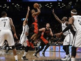 Toronto Raptors Terrence Ross shoots over Brooklyn Nets Kevin Garnett during their NBA game at the Barclays Center on January 27, 2014