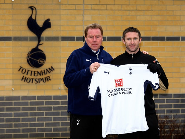 Spurs manager Harry Redknapp poses with new signing Robbie Keane at a Tottenham Hotspur training session at Spurs Lodge on February 6, 2009