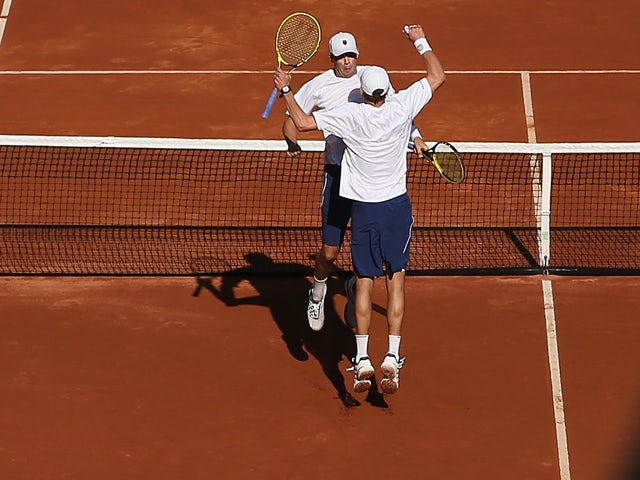 Bob Bryan and Mike Bryan of the United States celebrate match point and a four set victory against Colin Fleming and Dominic Inglot of Great Britain in their doubles match during day two of the Davis Cup World Group first round between the U.S. and Great