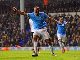 Manchester City's Vincent Kompany celebrates after scoring his team's fifth goal against Tottenham during their Premier League match on January 29, 2014