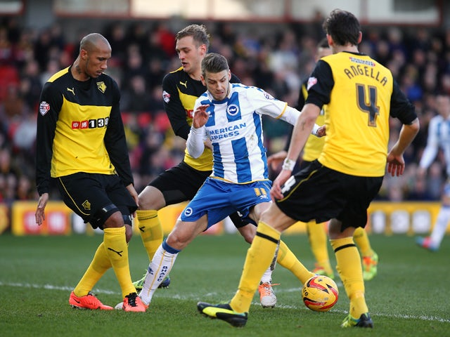 Andrea Orlandi of Brighton takes on the Watford defence during the Sky Bet Championship match between Watford and Brighton & Hove Albion at Vicarage Road on Febuary 02, 2014