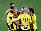 Carlos Hernandex of the Phoenix is surrounded by team mates after scoring his penalty goal during the round 17 A-League match between Wellington Phoenix and Adelaide United at Eden Park on February 1, 2014