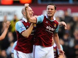 Kevin Nolan of West Ham United celebrates with James Collins as he scores their first goal during the Barclays Premier League match between West Ham United and Swansea City at Boleyn Ground on February 1, 2014