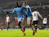 Manchester City's Yaya Toure celebrates after scoring his team's second goal via the penalty spot against Tottenham during their Premier League match on January 29, 2014