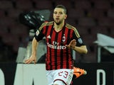 AC Milan's Adel Taarabt celebrates after scoring the opening goal against Napoli during their Serie A match on February 8, 2014
