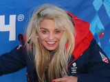 Aimee Fuller of the Great Britain Snowboard Team poses for a photograph in front of a Sochi 2014 sign on February 6, 2014