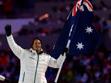 Snowboarder Alex Pullin of the Australia Olympic team carries his country's flag during the Opening Ceremony of the Sochi 2014 Winter Olympics at Fisht Olympic Stadium on February 7, 2014