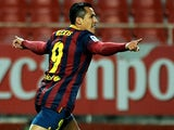 Barcelona's Alexis Sanchez celebrates after scoring his team's first goal against Sevilla on February 9, 2014