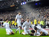 Real Madrid's Argentinian midfielder Angel di Maria (R) is congratuled by his teammates after scoring during the Spanish Copa del Rey (King's Cup) semifinal first-leg football match on February 5, 2014