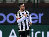 Udinese's Antonio Di Natale celebrates after scoring his team's opening goal against Chievo Verona during their Serie A match on February 8, 2014