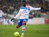 Lyon's French midfielder Arnold Mvuemba shoot the ball during the French L1 football match Lyon vs Lorient February 24, 2013