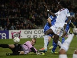 Lyon's French forward Bafetimbi Gomis (R) shoots and scores against Troyes' French goalkeeper Matthieu Dreyer (L) during the French League Cup semi-final football match on February 5, 2014