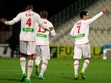 Ajaccio's Benjamin Andre scores his team's second goal against Rennes during their Ligue 1 match on February 8, 2014