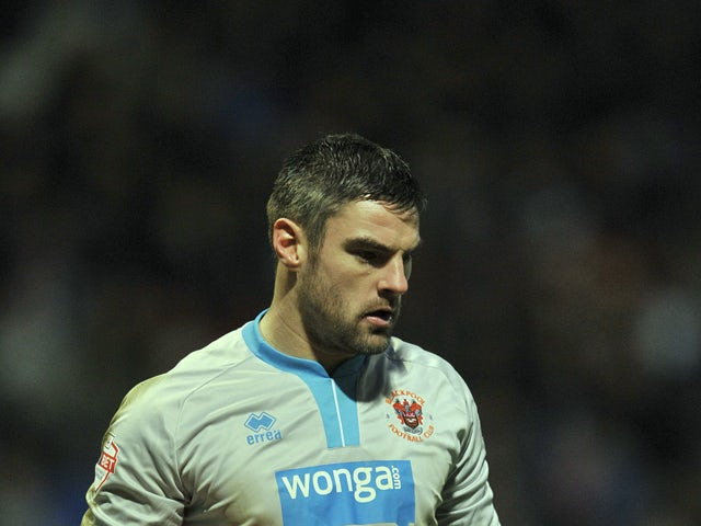 Matt Gilks of Blackpool during the FA Cup Third Round match between Bolton Wanderers and Blackpool at the Reebok Stadium on January 4, 2014