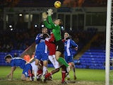 Bobby Olejnik of Peterborough United saves from Nile Ranger of Swindon Town during the Johnstone's Paint Southern Area Final on February 5, 2014
