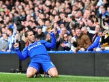 Chelsea's Belgian midfielder Eden Hazard celebrates scoring his second goal during the English Premier League football match between Chelsea and Newcastle United at Stamford Bridge in west London on February 8, 2014