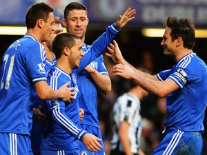 Eden Hazard of Chelsea is congratulated by team mates including Frank Lampard after scoring his third goal from the penalty spot during the Barclays Premier League match between Cheslea and Newcastle United at Stamford Bridge on February 8, 2014
