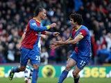 Marouane Chamakh of Palace celebrates with Mile Jidnak after scoring their third goal of the game with team mate Mile Jedinak during the Barclays Premier League match between Crystal Palace and West Bromwich Albion at Selhurst Park on Febuary 08, 2014