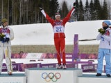 Gold winner Switzerland's Dario Cologna celebrates after the Men's Cross-Country Skiing 15km + 15km Skiathlon at the Laura Cross-Country Ski and Biathlon Center during the Sochi Winter Olympics on February 9, 2014