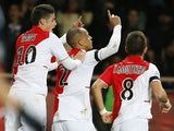 Monaco's Fabinho celebrates with teammates after scoring the equaliser against PSG during their Ligue 1 match on February 9, 2014