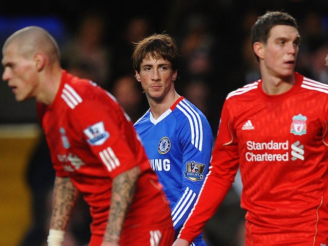 Fernando Torres of Chelsea looks across a Liverpool defenders Martin Skrtel (L), Daniel Agger (2R) and Jamie Carragher )R) during the Barclays Premier League on February 6, 2011