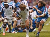 France's hooker Dimitri Szarzewski evades Italy's prop Martin Castrogiovanni during the Six Nations international rugby union match France vs Italy, on February 9, 2014