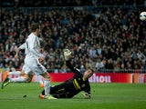Real's Gareth Bale scores the opening goal against Villarreal during their La Liga match on February 8, 2014