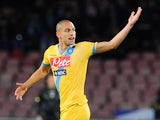 Napoli's Gokhan Inler celebrates after scoring his team's first goal against AC Milan during their Serie A match on February 8, 2014