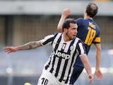 Juventus' forward Carlos Tevez celebrates after scoring during the Italian Serie A football match Hellas Verona Vs Juventus on February 9, 2014