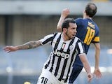Juventus' forward Carlos Tevez celebrates after scoring during the Italian Serie A football match Hellas Verona Vs Juventus on February 9, 2014