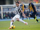 Juventus' Argentinian forward Carlos Tevez shoots and scores his second goal during the Italian Serie A football match Hellas Verona Vs Juventus on February 9, 2014