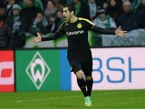 Dortmund's Henrikh Mkhitaryan celebrates after scoring his team's second goal against Werder Bremen during their Bundesliga match on February 8, 2014