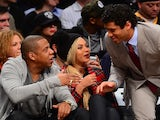 Singer Jay Z, his wife singer Beyonce and Seattle Seahawks quarterback Russell Wilson watch the NBA game between the Philadelphia 76ers and the Brooklyn Nets at the Barclays Center on February 3, 2014