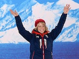 Great Britain's bronze medalist Jenny Jones waving to the crowd on the podium during the Women's Snowboard Slopestyle Medal Ceremony at the Sochi medals plaza during the Sochi Winter Olympics on February 9, 2014