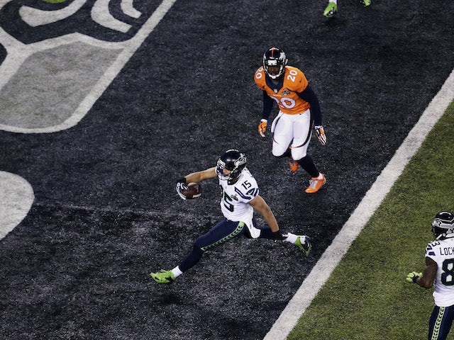 Wide receiver Jermaine Kearse #15 of the Seattle Seahawks scores a 23 yard touchdown during Super Bowl XLVIII against the Denver Broncos at MetLife Stadium on February 2, 2014