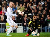 Real's Jese scores his team's third goal against Villarreal during their La Liga match on February 8, 2014