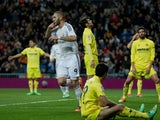 Real's Karim Benzema scores his team's second goal against Villarreal during their La Liga match on February 8, 2014