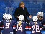 Head coach Katey Stone of the United States talks to her team on the bench during the Women's Ice Hockey Preliminary Round Group A Game against Finland on day 1 of the Sochi 2014 Winter Olympics at Shayba Arena on February 8, 2014